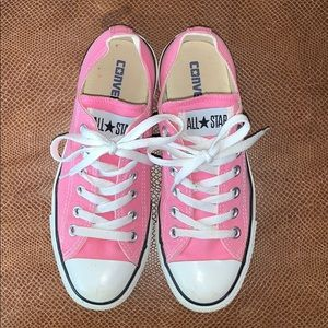 Pink Converse Taylor All Star shoes.